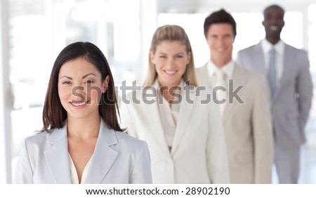 Smiling female business leader in front of team