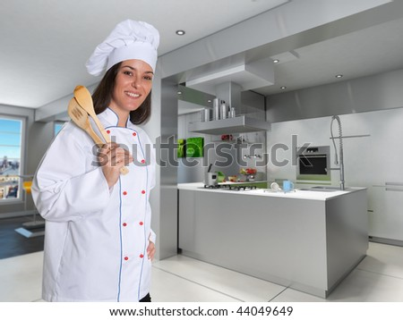 Smiling female chef in a modern kitchen with cooking tools