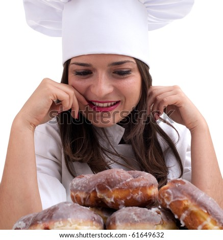 smiling female chef in white uniform and hat with donuts