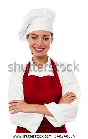 Smiling female chef isolated on white - stock photo