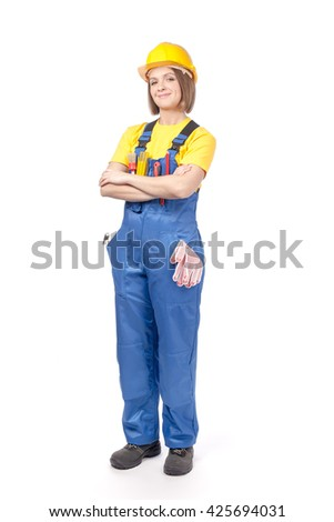 smiling female construction worker or decorator in yellow hardhat and workwear isolated on white background