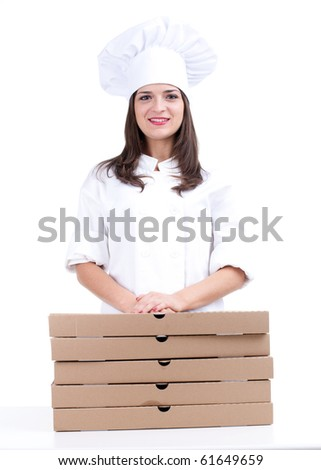 smiling female cook in white uniform and hat with boxes of pizza
