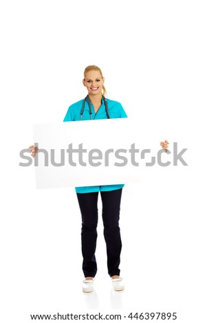Smiling female doctor or nurse holding empty banner - stock photo