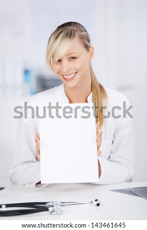 Smiling female doctor showing documents in a front view shot - stock photo