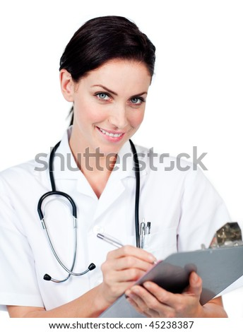 Smiling female doctor writing on a clipboard isolated on a white background