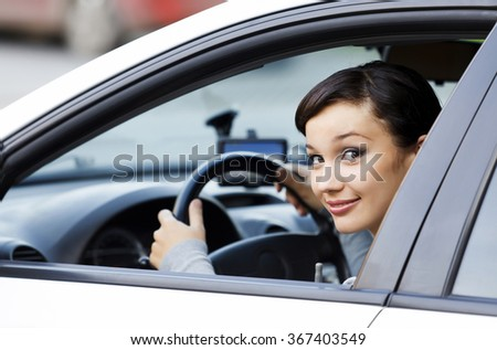 Smiling female driver - stock photo
