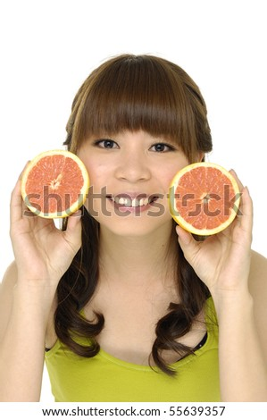 smiling female face with fresh grapefruit in her hands