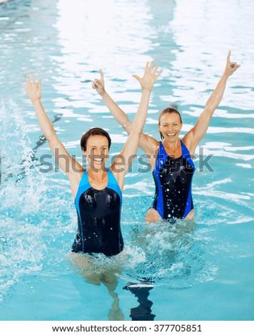 Smiling female fitness - stock photo
