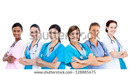 Smiling female hospital workers standing arms folded in line on white background - stock photo
