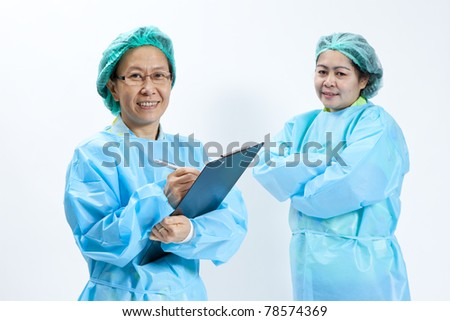 Smiling female medical doctor and nurse with stethoscope and clipboard