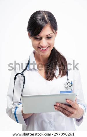 Smiling female medical doctor using tablet computer isolated on a white background - stock photo