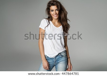 Smiling female model isolated on grey background - stock photo