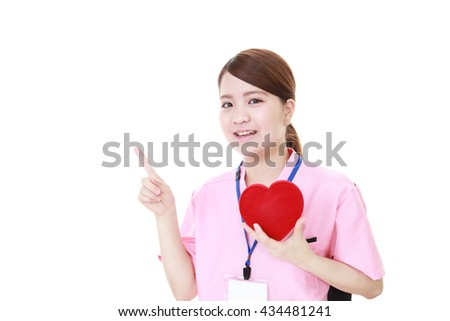 Smiling female nurse - stock photo