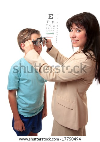 Smiling female optometrist stands with a child patient. - stock photo