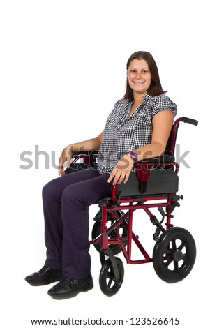 Smiling female patient in a wheelchair - stock photo