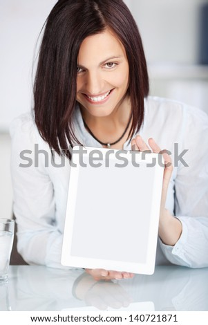 Smiling female showing her tablet touch in a front view shot - stock photo