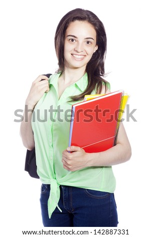 smiling female student carrying notebooks, isolated on white