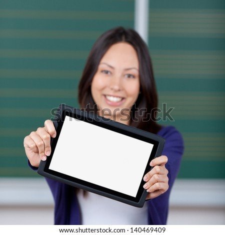 smiling female student displaying blank tablet-pc at university - stock photo