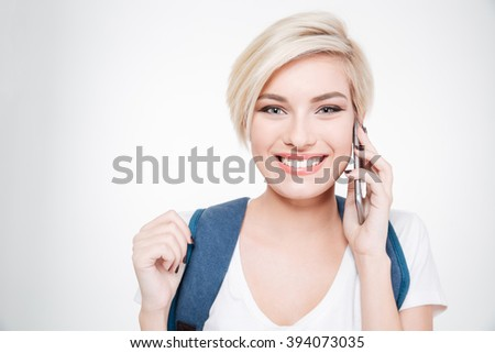 Smiling female student talking on the phone isolated on a white background