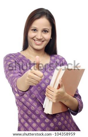 Smiling female student thumbs up