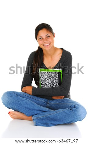 Smiling female teenage student sitting with her legs crossed with open notebook in her lap. Horizontal format isolated on white.