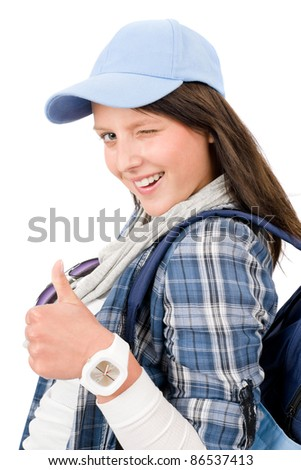 Smiling female teenager girl wear cool outfit thumb up - stock photo