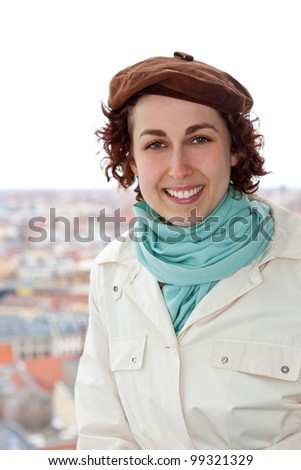Smiling female tourist in Berlin city on holiday picture - stock photo