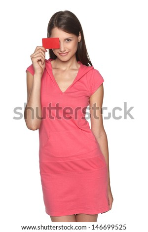 Smiling female wearing sport style pink dress showing blank credit card,  isolated on white background - stock photo