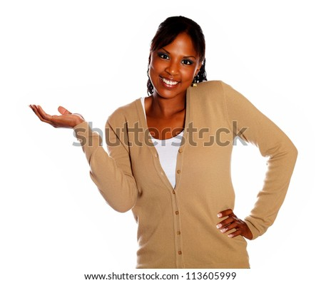 Smiling female with extended hand looking at you on isolated background