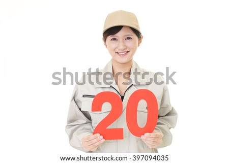 Smiling female worker  - stock photo