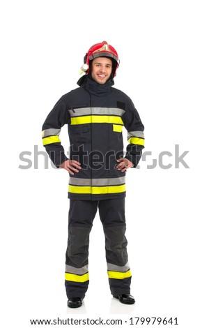 Smiling firefighter posing, front view. Full length studio shot isolated on white. - stock photo