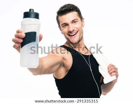 Smiling fitness man holding towel and bottle with water isolated on a white background - stock photo