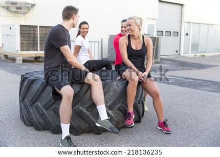 Smiling fitness team taking a break - stock photo
