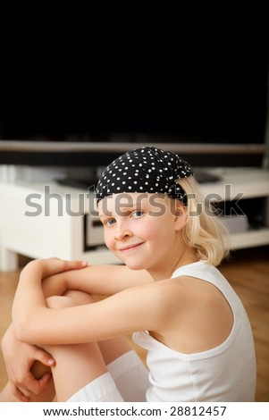 Smiling freetime in childhood watching tv - stock photo