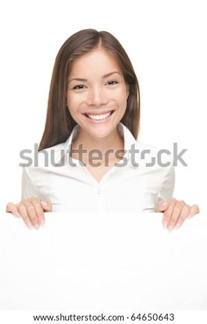 Smiling friendly young woman showing white blank sign with copyspace. Isolated on white background - stock photo