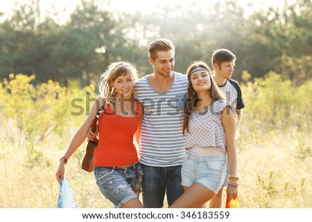 Smiling friends having fun in the forest outdoors