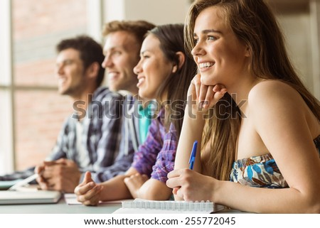 Smiling friends students talking and writing at school - stock photo