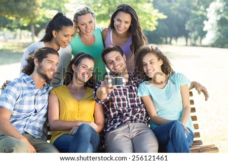 Smiling friends taking a selfie on a sunny day
