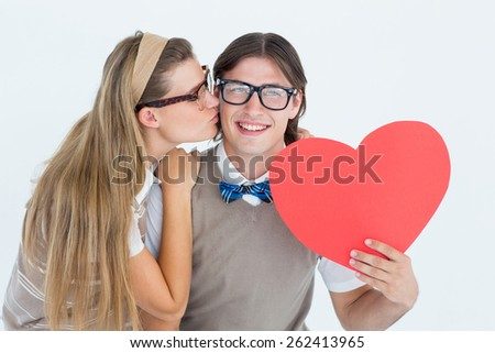 Smiling geeky hipster and his girlfriend on white background - stock photo