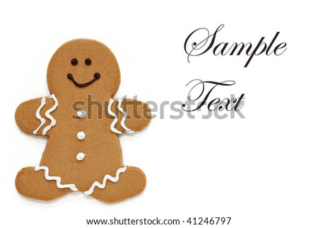 Smiling gingerbread man on white background with copy space. - stock photo