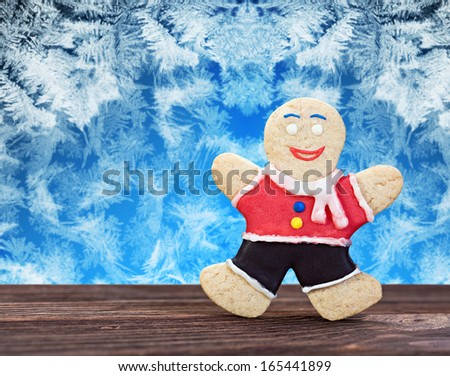 Smiling gingerbread men on a frozen background - stock photo