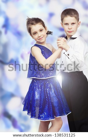 Smiling girl and boy dancing on pink background - stock photo