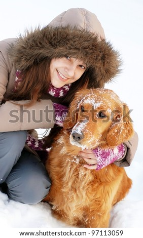 Smiling girl and her dog - stock photo
