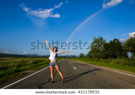 Smiling girl and rainbow