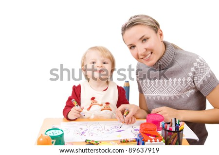 Smiling girl drawing with her mother over white