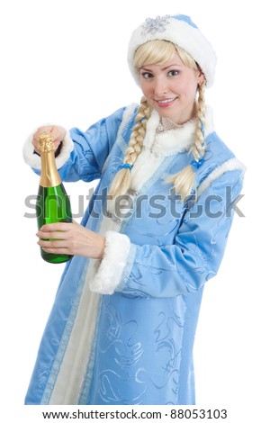 smiling girl dressed in traditional russian christmas costume of Snegurochka (Snow Maiden) opens bottle of champagne, isolated on white background
