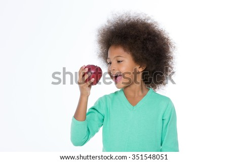 smiling girl eat an apple isolated on a white background - stock photo