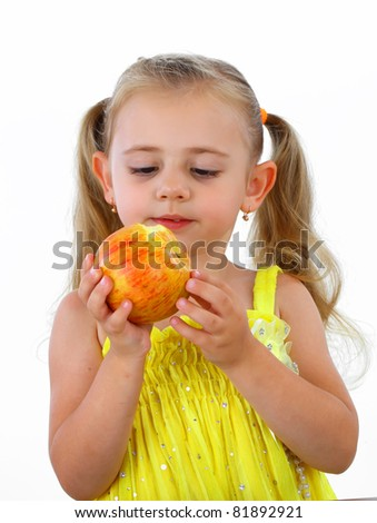 Smiling girl eating apple - stock photo