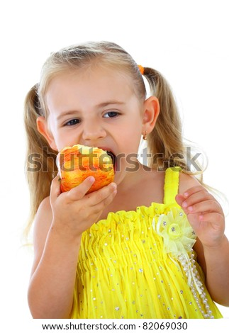 Smiling girl eating apple