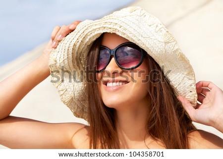 Smiling girl enjoying summer sun and leisure - stock photo